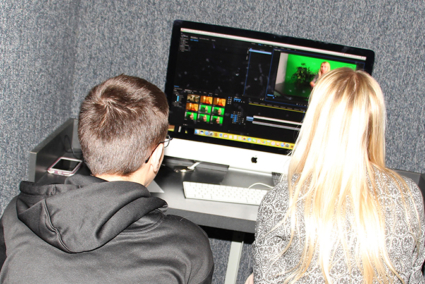 Two students editing a video