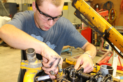 A student working on an engine.