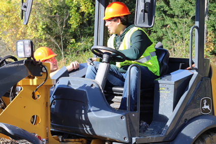 An operator driving a machine