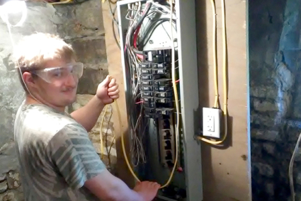 A student in front of a breaker board