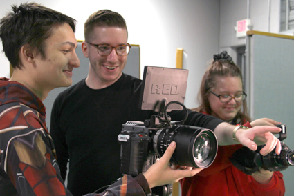 Three students recording a video