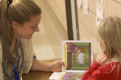 A student reading with a child